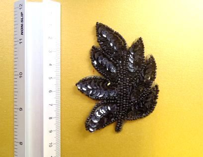 black sequin leaves