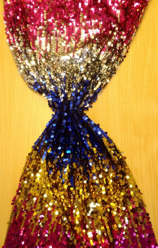 cerise/gold tye dye sequin on net